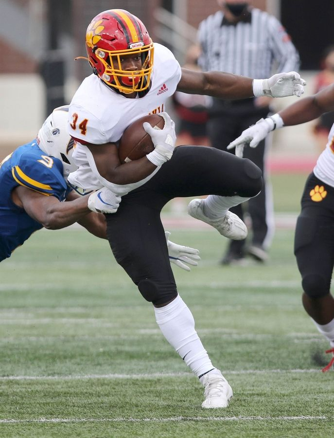 Batavia running back Josh Dornink breaks the tackle of Wheaton North cornerback Joseph Swaray Jr. during their game Saturday afternoon in Huskie Stadium at Northern Illinois University.