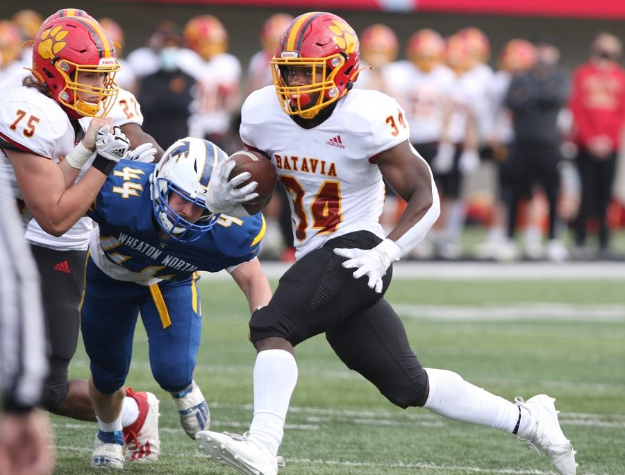 Batavia running back Josh Dornink finds room to run in the Wheaton North defense during their game Saturday afternoon in Huskie Stadium at Northern Illinois University.
