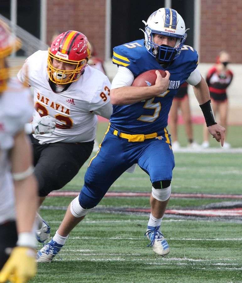 Wheaton North quarterback Mark Forcucci scrambles for yardage as he is pressured by the Batavia defense during their game Saturday afternoon in Huskie Stadium at Northern Illinois University.