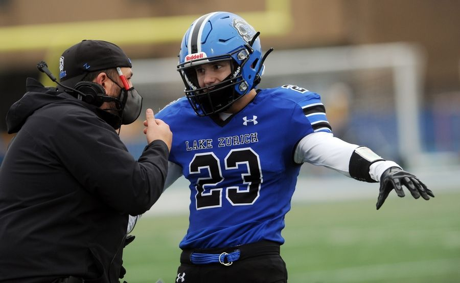 Lake Zurich's Nick Alvey takes directions from defensive coordinator Nick Summers earlier this season. The Bears closed out the spring football season with a 6-0 win over Stevenson on Friday night.