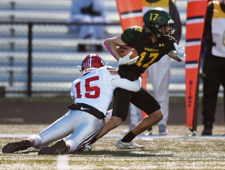 Glenbrook North's Dylan Yoss, right, gets tackled by Deerfield's Alex Fern during Friday's game in Northbrook.