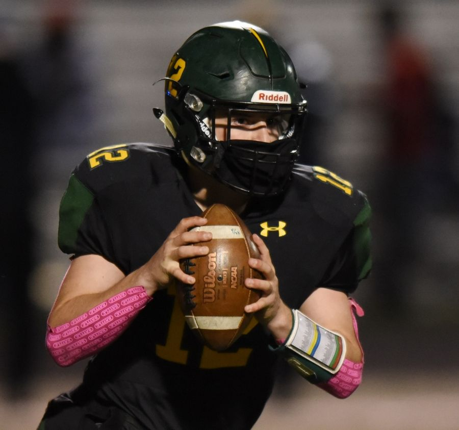 Glenbrook North quarterback Murphy Mulvihill looks for an open receiver during Friday's game against Deerfield.
