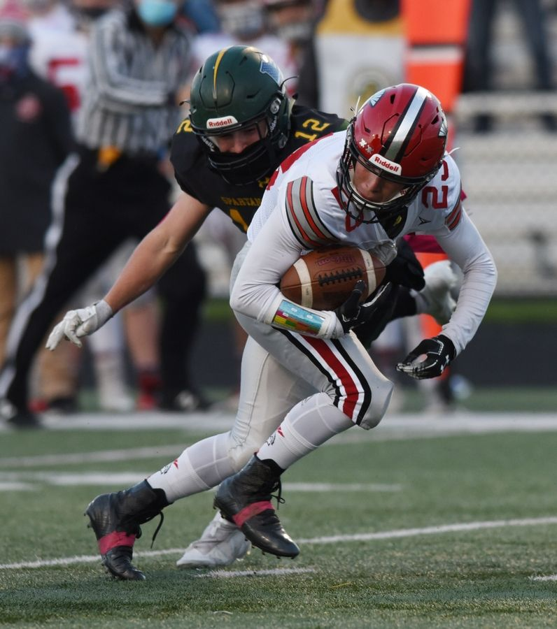 Glenbrook North's Murphy Mulvihill, left, closes in on Deerfield's Zachary Pomerantz during Friday's game in Northbrook.