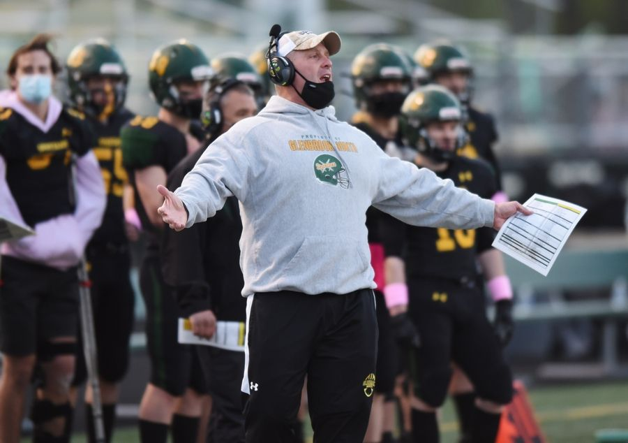 Glenbrook North head football coach Matt Purdy questions why Deerfield wasn't called for delay of game while making substitutions to go for a two-point conversion during Friday's game in Northbrook.