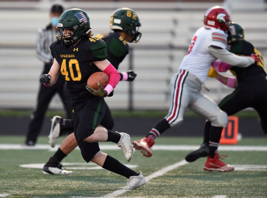 Glenbrook North's Quinn Clarke carries the ball during Friday's game against Deerfield.