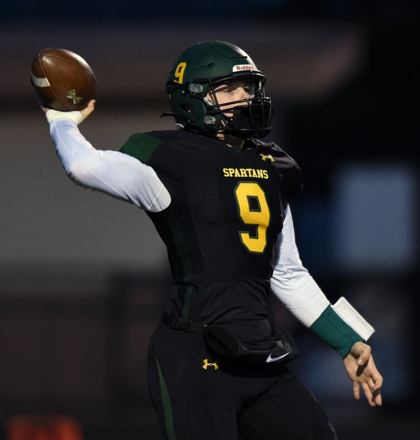 Glenbrook North quarterback Avery Burow throws a pass during Friday's game against Deerfield.