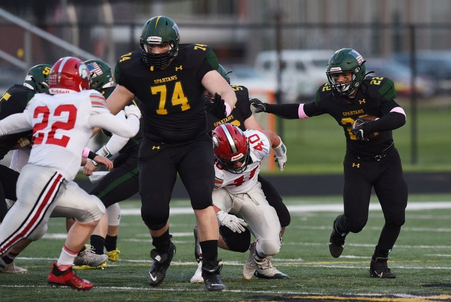 Glenbrook North's Drake Marquez, right, evades Deerfield's Andrew Bender during Friday's game in Northbrook.